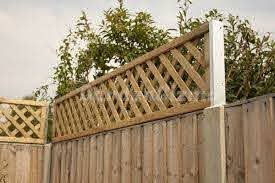 Extend Height Of A Fence Increase The Height Of Your Fence With Trellis Fence Extension Backyard Fence Ideas Privacy Backyard Fences Backyard Privacy
