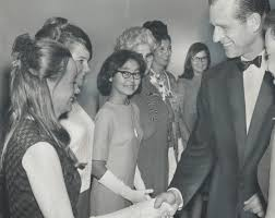 Prince Philip Meets The Ladies; Glenna Graham (right) YWCA program director  for Canada; watches Prince Philip shake hands with Marni Churchill at YWCA  annual meeting yesterday. : Digital Archive : Toronto Public Library