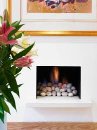gas fireplace with rocks instead of