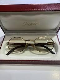 gold wood frame brown lens gles