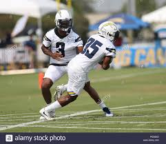 August 09, 2018 Costa Mesa, CA...Los Angeles Chargers quarterback Geno  Smith #3 handing off to Los Angeles Chargers running back Russell Hansbrough  #35 during the Los Angeles Chargers Training Camp in Costa