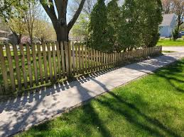 American Fence Company Sloped Dog Eared Wood Picket Fence American Fence Company Of Iowa City Ia