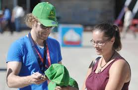 Country singer Adam Gregory autographs a cap for Karley Congo ...