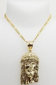 solid gold face pendant charm