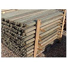 Farm And Garden 10 X 1 2m 4ft Tall X 50mm Diam 15 Year Guaranteed Pressure Treated Wooden Fence Posts Stakes Ideal For Garden Fencing Amazon Co Uk Garden Outdoors