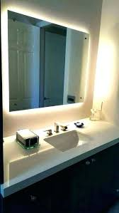 led light strip behind bathroom mirror