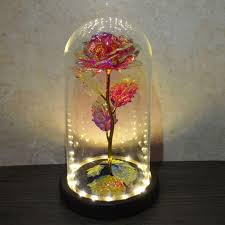 red rose gift in glass dome wooden base