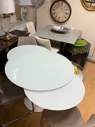 white circular extending dining table