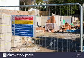 Construction Site Safety Notices And Fence House Building Empty Stock Photo Alamy