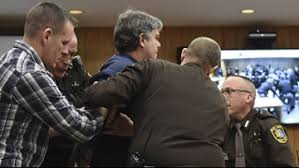 Judge won't punish father who tried to attack Larry Nassar | kgw.com