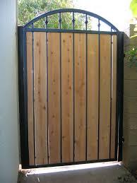 Iron Gates W Wood Fencing Around You House Gate Design Iron Garden Gates Wood Gate