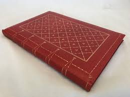 large red leather bound blank book with