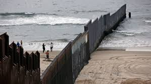 Where The Border Fence Meets The Sea A Strange Beach Scene Contrasting The U S And Mexico Los Angeles Times
