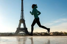 young woman running on the eiffel tower