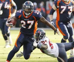 Running back Knowshon Moreno (27) slips past Houston Texans safety  Dominique Barber – Denver Broncos History