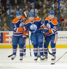 Iiro Pakarinen (62) of the Edmonton Oilers is helped off the ice ...