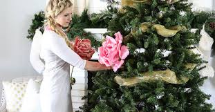 she tucks a giant flower into her tree