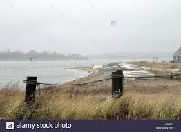 Two Large Fence Posts Connected Rope Windswept Grass In Front Beach Stock Photo Alamy