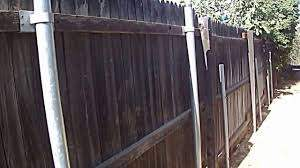 Wood Fence With Round Galvanized Steel Posts And Brackets Youtube