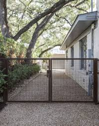 10 Genius Garden Hacks With Rusted Metal Gardenista Metal Driveway Gates Backyard Fences Fence Design