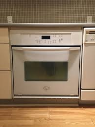 wall oven and cooktop with a slide in range