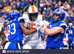 St Louis, USA. 29th Feb, 2020. Feb 29, 2020: Seattle Dragons defensive end  Jacquies Smith (95) gets double teamed by St. Louis Battlehawks tight end Wes  Saxton (83) and St. Louis Battlehawks