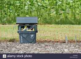 Portable Solar Power Battery Unit And Electric Fence Around A Crop Of Stock Photo Alamy