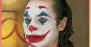 makeup artist creates joker halloween