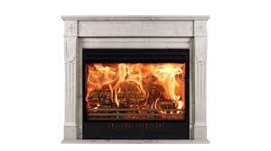 burning fireplace of white marble