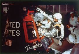 Image result for John Hershel Glenn Jr. becomes the first American to orbit Earth.