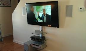 tv on wall shelf cable box dvd player