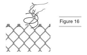 A Hand Is Splicing Chain Link Fence With Tie Wires Chain Link Fence Installation Chain Fence Chain Link Fence