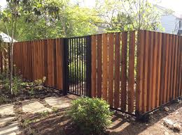 Vertical Wood Fence With Metal Frame Craftsman Landscape Houston By Architectural Fabricators