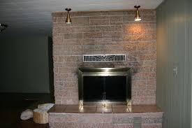 black soot on fireplace brick granite