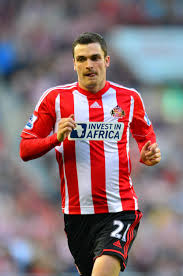 Who is Adam Johnson and when was the ex-Sunderland football player released  from prison?