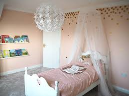 Peach And Gold Girl S Bedroom With Gold Spot Stickers And Bed Canopy Bedroom Design Luxurious Bedrooms Girls Bedroom Bedding