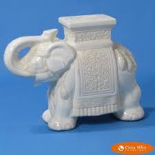 white yellow elephant garden seat