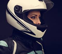 rider woman looking in white motorcycle