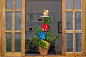 diy vertical herb garden made of pots