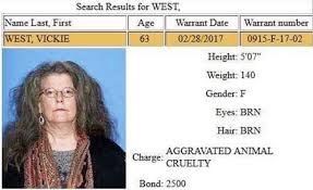 "Four legged friends (and enemies): Arkansas: Vickie West, 63, was accused  of ""rescue shopping"" in multiple states. Found hoarding nearly 30 dogs in  house with 3-feet of fecal matter - along with 3 dead dogs"