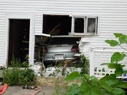 car crashes through building at main