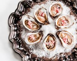 Oysters on the half shell with ...
