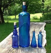 centerpiece colored glass bottles
