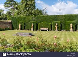 Grave of Margaret Greville in the grounds of Polesden Lacey, West Sussex  Stock Photo - Alamy