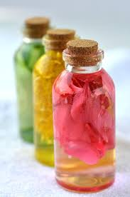 rose infusions in glass bottles