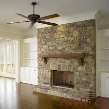 stone fireplace with crown molding