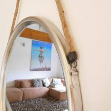 large round silver metal mirror on