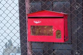 Red Mailbox Hanging On Chain Link Fence Stock Photo Picture And Royalty Free Image Image 79922717