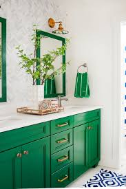green and neutral bathroom with mirrors