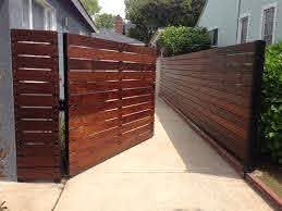 Image Of News All County Fence And Gate Throughout Retractable Driveway Gate Retractable Driveway Gate Design Ideas Patio Fence Wood Fence Design Fence Design